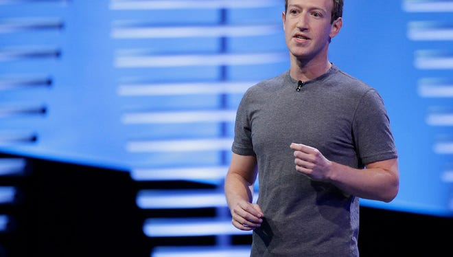 In this April 12, 2016, file photo, Facebook CEO Mark Zuckerberg speaks during the keynote address at the F8 Facebook Developer Conference in San Francisco. In a blog post Wednesday, May 3, 2017, Zuckerberg said that Facebook will hire another 3,000 people to review videos of crime and suicides following murders shown live.