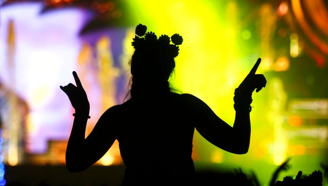 A woman dances as Hardwell performs at the Kinetic Field stage during the opening night of the Electric Daisy Carnival at the Las Vegas Motor Speedway in Las Vegas on Saturday, June 17, 2017.