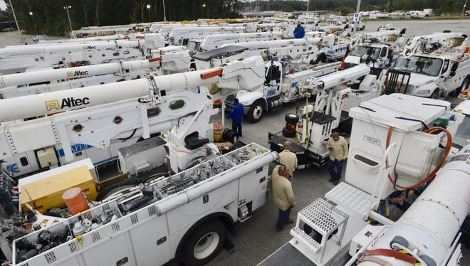 Dozens of trucks stage on Saturday, Oct. 7, 2017, at the Pensacola Interstate Fairgrounds in preparation for Hurricane Nate.