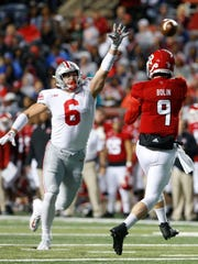 Rutgers quarterback Kyle Bolin gets a pass off despite pressure from Ohio State defensive end Sam Hubbard.