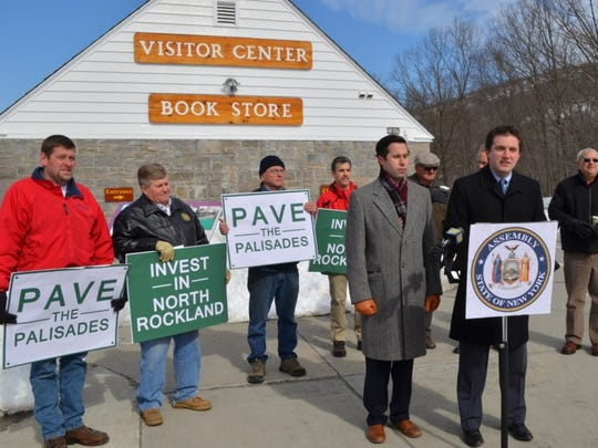 Assemblyman James Skoufis, at podium, and  Assemblyman Ken Zebrowski in February called on the state DOT to make short- and long-term fixes to the Palisades Interstate Parkway. Repairs will begin this fall.