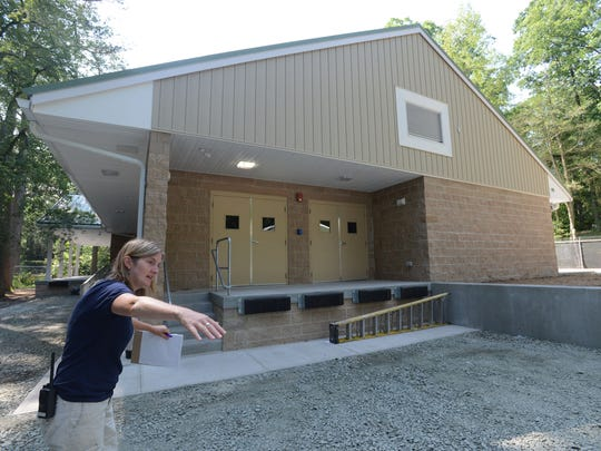 Mary Seemann, Marketing and Development director for the Salisbury Zoo, stands outside the new Animal Health Clinic Center at The Salisbury Zoo.