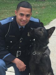 Vineland Police Officer Johnathan Ramos with his K-9 partner, Rexo.