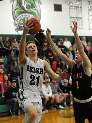 Fisher Catholic senior Zach Saffell goes for a shot during a game earlier this season against Berne Union. The Rockets selected as the No. 1 seed in the upcoming Division IV tournament.