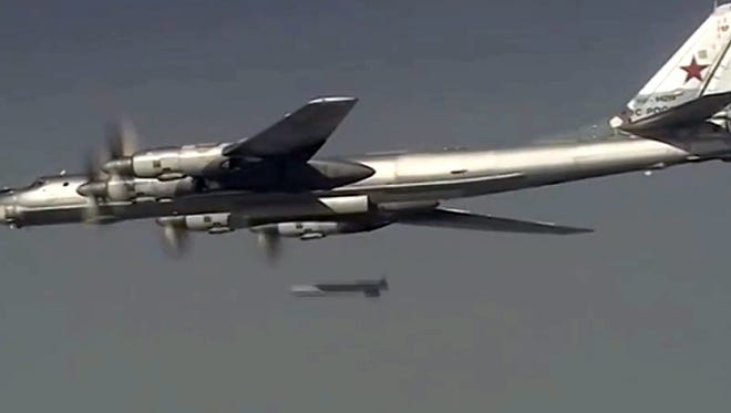 epa05029936 A handout frame grab from video footage published on the official website of the Russian Defence Ministry 17 November 2015 shows Russian TTu-95MS turboprop-powered strategic bomber releasing a missile against Islamic State targets in Syria. Russian Tu-160, Tu-95MS, Tu-22 M3 long-range aviation warplanes based in Russian territory carried out airstrikes against what Russia says were Islamic State targets in Syria.  EPA/RUSSIAN DEFENCE MINISTRY PRESS SERVICE / HANDOUT BEST QUALITY AVAILABLE HANDOUT EDITORIAL USE ONLY/NO SALES ORG XMIT: FET09