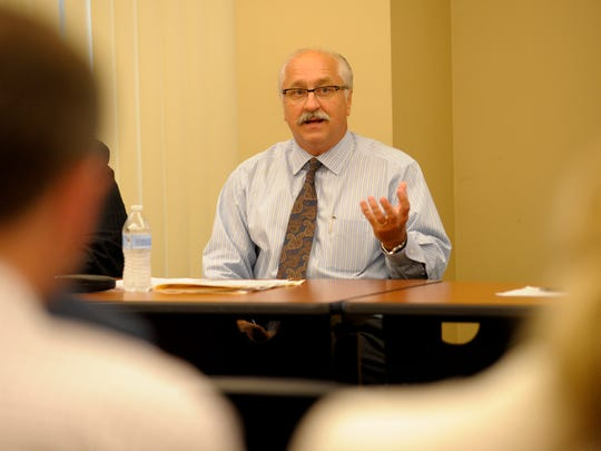 Lafayette Parish Clerk of Court Louis Perret speaks during a panel discussion on the process of  school board election at the Daily Advertiser in Lafayette, La., Thursday, Aug. 7, 2014. Paul Kieu