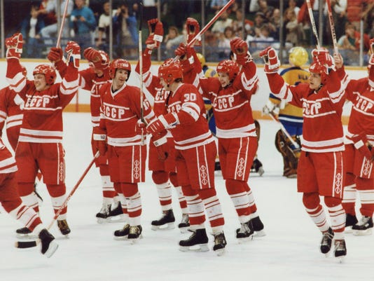FILE - In this Feb. 26, 1988, file photo, members of the Soviet hockey team skate across the ice with their sticks raised in victory after defeating Sweden to clinch the gold medal at the 1988 Winter Olympics in Calgary, Alberta. After a week of turmoil for Olympic hockey, Russia thinks it is poised to be the big winner next February in South Korea. Its fans have waited more than 25 years for an Olympic gold medal, and its top league wants to fight the NHL for international markets, so the absence of NHL players in Pyeongchang could be a golden opportunity. ( Philip Walker/The Canadian Press via AP, File)