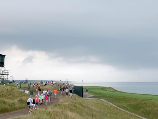 Dark clouds caused the evacuation of areas at Whistling Straits on Aug. 10. The stoppage and evacuation of areas on the course was a safety precaution because of stormy weather.