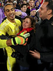 Louisville City FC goalkeeper Greg Ranjitsingh, left, celebrates with his parents following Louisville's 1-0 victory in the USL Cup match with the Swope Park Rangers on Monday evening at Louisville Slugger Field. Nov. 13, 2017