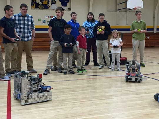 Students from the St. Mary Catholic High School Vex Club visited St. Margaret Mary Elementary School to demonstrate their award-winning Vex Robots. A few students got the opportunity to drive the robots. Students from St. Margaret Mary Jr. Vex also had the opportunity to share the work they have done this year.