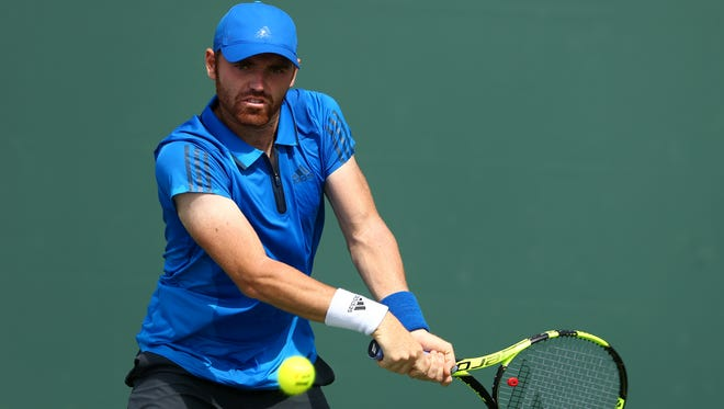 Bjorn Fratangelo of the United States plays a backhand during his straight sets victory in his final qualifying round match against James Ward of Great Britain during the Miami Open Presented by Itau at Crandon Park Tennis Center at Crandon Park Tennis Center on March 22, 2016 in Key Biscayne, Florida.