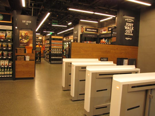 The Amazon Go convenience store at Amazon's headquarters in Seattle. It features Just Walk Out technology which allows shoppers who have the Amazon Go app to walk in, grab what they want, and walk out - all without going through a checkout line. The costs are automatically charged to their account.