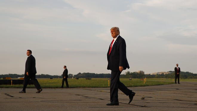 President Donald Trump walks to Marine One after stepping off Air Force One at Morristown Municipal Airport in Morristown, N.J., Friday, July 24, 2020. Trump is spending the weekend at his golf club in nearby Bedminster, N.J.