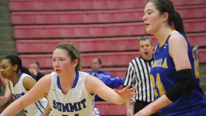 Summit Country Day's Meghan O'Brien, No. 34, defends Madeira's Jamie Grob in a Division III sectional semifinal at Fairfield High School on Feb. 17. Madeira won 49-37 over Summit.