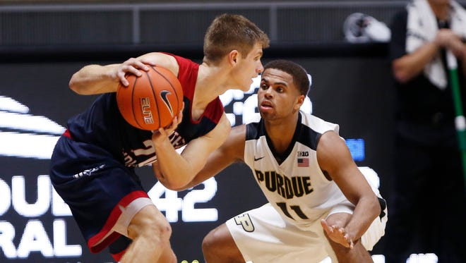 P.J. Thompson keeps an eye on Alex Stein of Southern Indiana Tuesday, November 1, 2016, at Mackey Arena. Purdue defeated Southern Indiana 85-63.