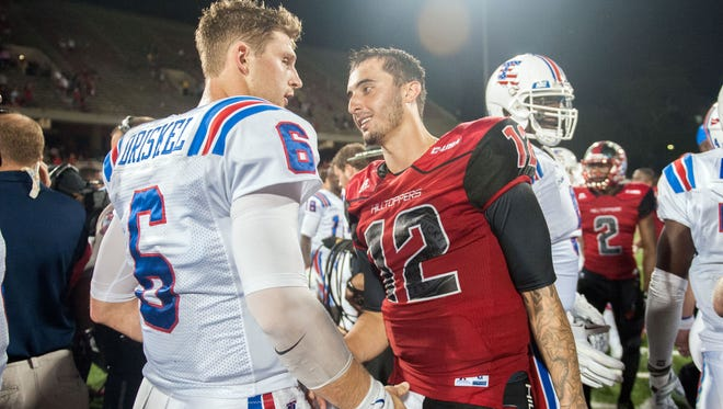 Western Kentucky Hilltoppers quarterback Brandon Doughty (12) shakes hands with Louisiana Tech quarterback Jeff Driskel (6) during their game earlier this season in Bowling Green, Kentucky.
