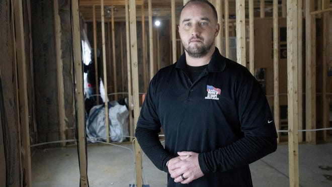 """Veteran Michael Gower says the house in Middleville will enable him """"to move around the house with no problem, to go to the bathroom, cook dinner, take a shower ... ."""""""