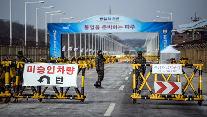 South Korean soldiers patrol the road connecting South and North Korea at the Unification Bridge near the Demilitarized Zone (DMZ) near Panmunjom, South Korea.