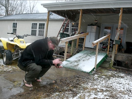 After his son, Ayden Zeigler-Kohler, died of a rare cancer known as DIPG, Bill Kohler traveled the country, collecting jars of dirt from the homes of children who have the same disease has his son. He is seen here collecting a sample from a home in Maryland in February.