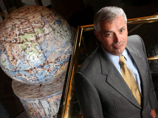 Principal Financial Group CEO Larry Zimpleman with the globe as a backdrop, representing how PFG's world-wide business had grown since the company went public 10 years ago.