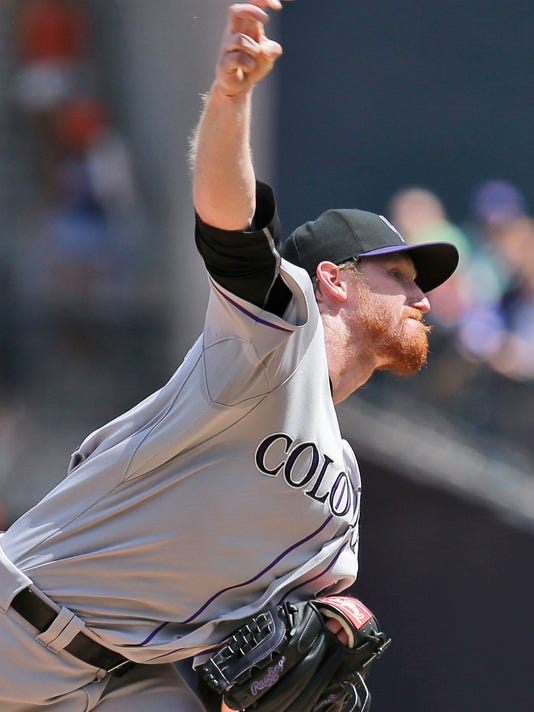 Colorado Rockies starting pitcher Eddie Butler throws during the first inning of a baseball game against the New York Mets at Citi Field, Thursday, Aug. 13, 2015, in New York. (AP Photo/Seth Wenig)