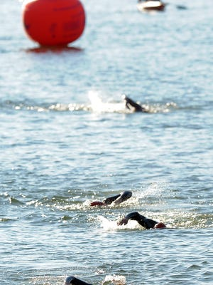 Racers swim in Horestooth Reservoir during the Xterra Lory Triathlon Saturday morning August 10, 2013 at Lory State Park.