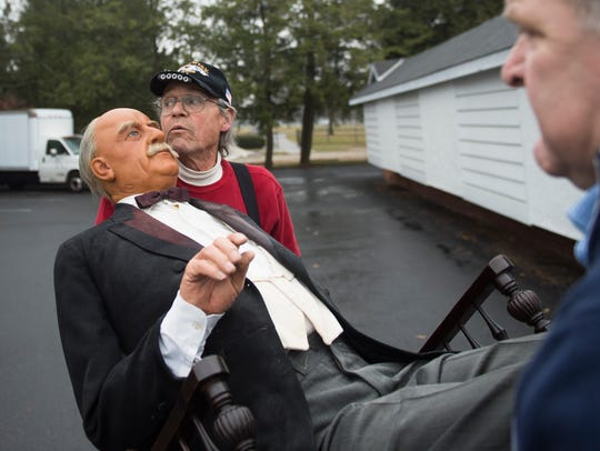Lou Frederick, of Littlestown, helps move a wax figure