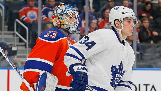 Maple Leafs forward Auston Matthews (34) tries to screen Oilers goaltender Cam Talbot (33) during the second period.