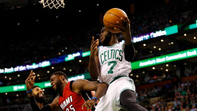 The Boston Celtics' Jaylen Brown (7) looks to pass the ball against the Miami Heat.