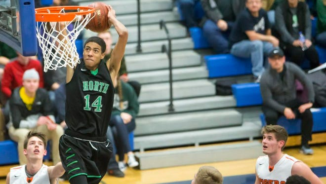 Oshkosh North's Tyrese Haliburton goes up for a dunk during a nonconference tournament game against Marshfield on Saturday at Oshkosh West High School.