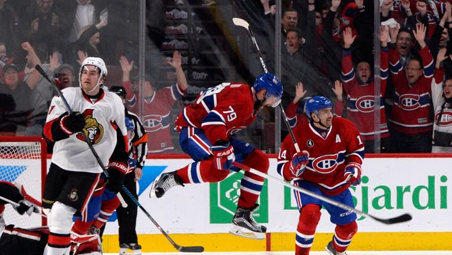 Montreal Canadiens defenseman Andrei Markov (79) reacts after teammate Montreal Canadiens forward Alex Galchenyuk (27) (not pictured) scored the winning goal during the overtime period against the Ottawa Senators in game two of the first round of the the 2015 Stanley Cup Playoffs at the Bell Centre.