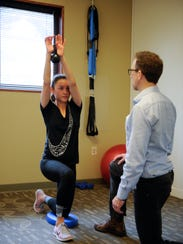 Dr. Peter Arndt helps Crystal Kokacovich perform a