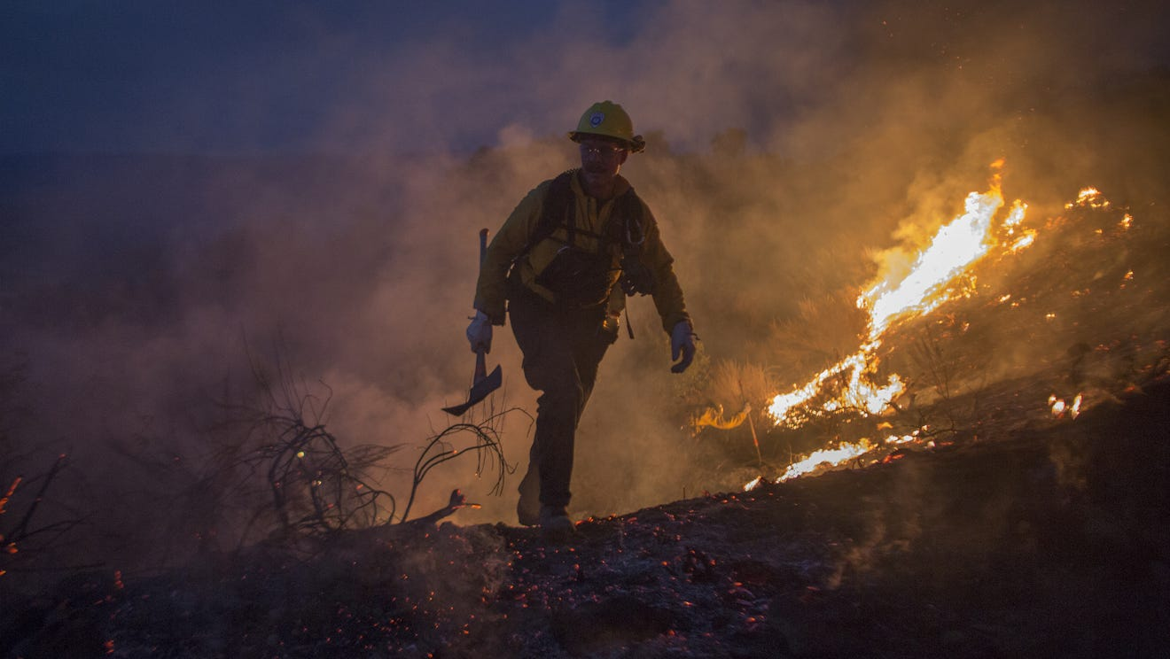 Trump threatens to cut off funds for California forest fires