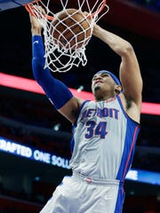 Pistons forward Tobias Harris (34) dunks during the second half of the Pistons' 93-79 win on Saturday, Dec. 30, 2017, at Little Caesars Arena.