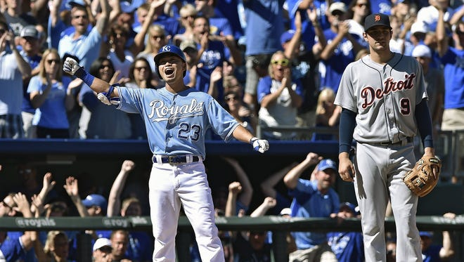 Kansas City Royals' Norichika Aoki (23) celebrates on third after hitting a grounder for a two-run triple against the Detroit Tigers to score Mike Moustakas and Omar Infante during the fourth inning on Sunday, Sept. 21, 2014, at Kauffman Stadium in Kansas City, Mo.