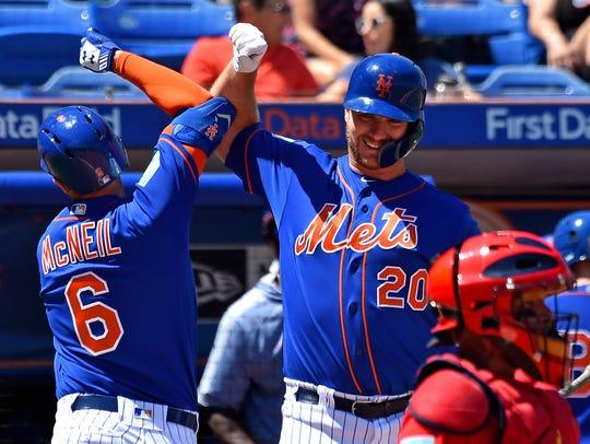 New York Mets infielder Jeff McNeil is greeted by teammate