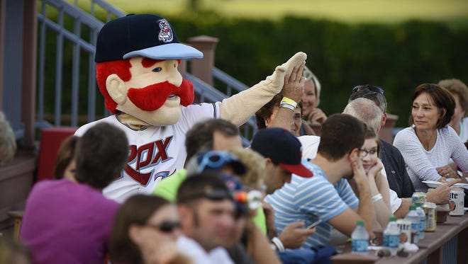 St. Cloud Rox mascot Chisel gets high-fives from the fans July 9 during the team's game against Duluth at Joe Faber Field.
