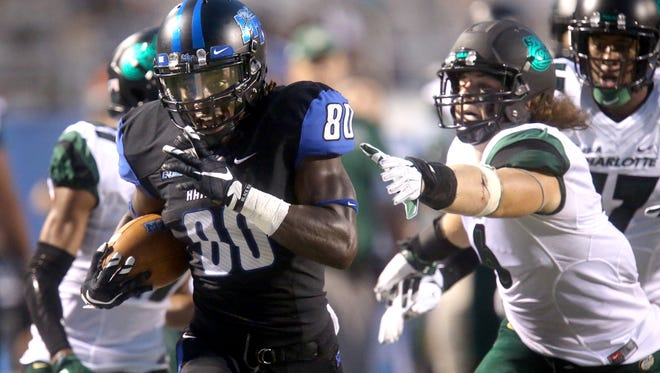 MTSU's Ed Batties (80) runs the ball down the field for at touchdown as Charlotte's Nick Cook (6) lunges toward Batties but can't catch him during the first half of an NCAA college football game Saturday, Sept. 19, 2015 in Murfreesboro, Tenn.