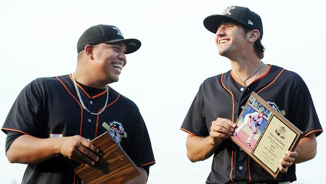 Erie SeaWolves pitcher Bruce Rondon, left, and infielder Nick Castellanos hold their plaques after being honored in 2012.