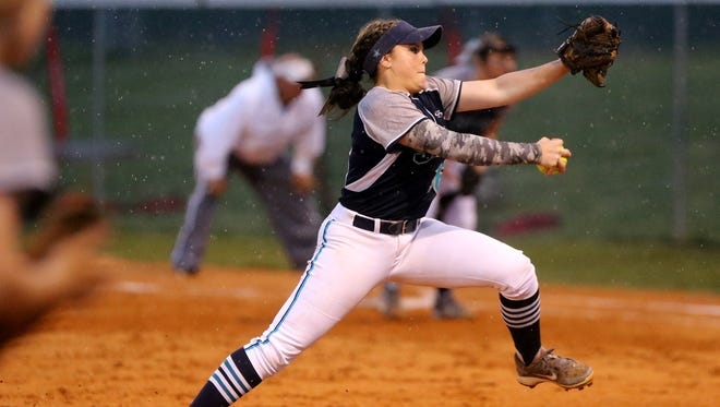 Siegel's Veronica Westfall (16) pitches in the rain against Tullahoma at Siegel, on Monday, May 16, 2016.