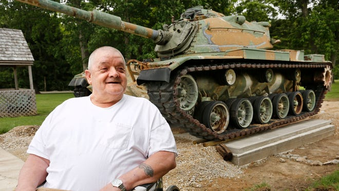 """Donald Slavens recalls his days of operating an M-60 Patton tank like the one on display (background) Thursday, May 25, 2017, at the Indiana Veterans Home in West Lafayette. Slavens drove one of the Cold War era tanks when he was in the Army National Guard. """"Real nice driving, but you don't want to be behind it when they fire,"""" said Slavens."""