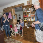 Just back from an extended stay at the hospital, Kenny Capps, right, is welcomed home last Thursday during a semi-surprise party at his home by friends and family members David LaMotte (from left), Murphy Capps, Georgia Capps, Olin Christenbury, Maggie Abernathy and others.
