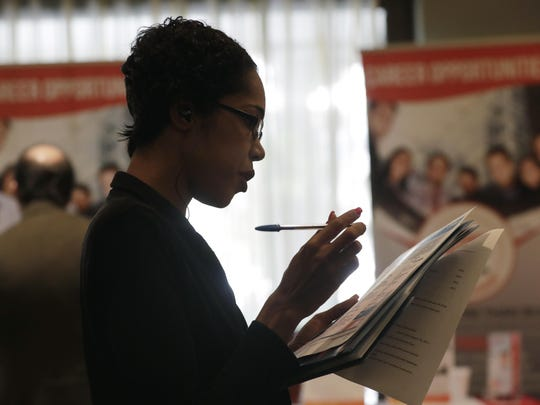 Joana Dudley of Lauderhill, Florida, surveys job prospects earlier this year. As the job market has tightened, businesses have complained that they can't find enough qualified workers to fill all their open jobs.