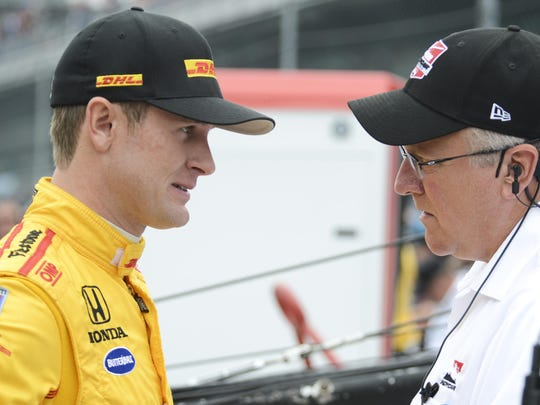 Ryan Hunter-Reay (28) talks with President of Race Operations for IndyCar, Brian Barnhart before qualifying at the Indianapolis Motor Speedway.
