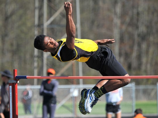 Northmor's Demetrius Johnson soars over the high jump pole during the Colonel Crawford Bob Royer Relays Friday evening.
