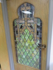 A stained glass window from the former church building