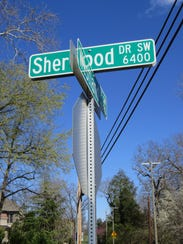 Sign leading to Neyland's former residence on Sherwood