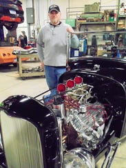 The 1928 Model A Roadster features a 1932 grill, channeling,