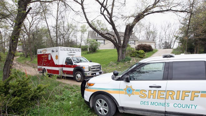 An ambulance leaves an apparent murder/suicide at 14733 Lynx St. Friday in rural Des Moines County.