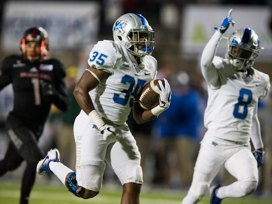 Middle Tennessee running back Terelle West (35) breaks away for a touchdown against Arkansas State as teammate wide receiver Ty Lee (8) cheers him on during the first half of the Camellia Bowl NCAA college football game, Saturday, Dec. 16, 2017 in Montgomery, Ala.  (Mickey Welsh/The Montgomery Advertiser via AP)
